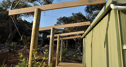 green shed with custom structure offside